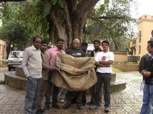 Dog handlers holding sack for catching dogs at Jeevashram near Rajokri, New Delhi.
